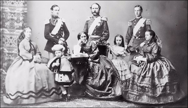 1862: Future King Christian IX of Denmark, His Wife Louise of Hesse-Kassel and Their Six Children at the Time of Princess Alexandra's Engagement to the Prince of Wales. Left to right: Dagmar, Frederick, Waldemar, Louise (Later Queen), Christian (Later King), Thyra, William, and Alexandra. (Aronson, Theo, A Family of Kings, The Descendants of Christian IX of Denmark, 1976, facing p. 116)