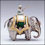 Diamond Trellis Egg Surprise (1892) and Automated Elephant (ca. 1900) (Courtesy Royal Collection)