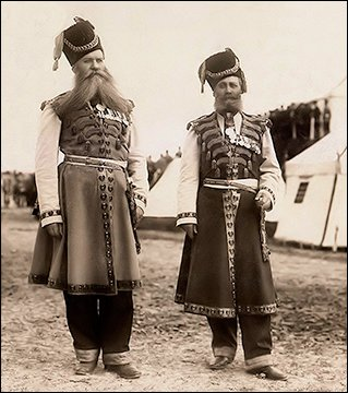 Center: Archival photograph of Kudinov and Pustynnikov in their ceremonial dress at annual military maneuvers presided over by Nicholas II in 1913. (Photographs Courtesy of Sammler.ru)