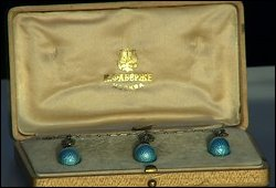 Discovery of a Fabergé necklace with sky blue pendant eggs in an original hollywood case valued at 12,000 GBP.