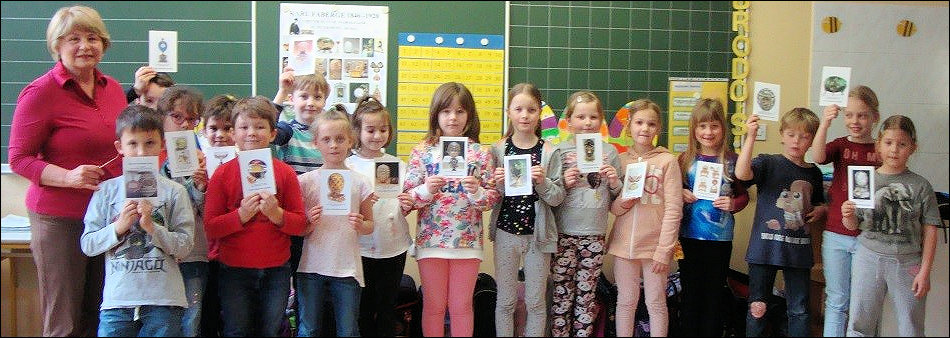 Passing the Baton! Teaching Second Grade Slovenian Children about Fabergé Imperial Eggs. Thanks to the efforts of newsletter contributor Riana Benko (left) each child took home a special Fabergé Easter egg.