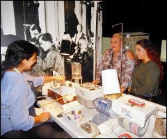 """Zainab """"Zee"""" R. Naqvi Demonstrating Lapidary Techniques to Visitors"""
